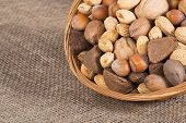 foto of brazil nut  - Mixed nut basket with almonds walnuts pecans hazelnuts and Brazil nuts - JPG