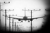 picture of lax  - Airplane landing at Los Angeles International Airport during sunset Los Angeles California USA - JPG