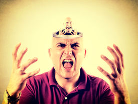 image of bald head  - Angry bald man with open head with himself in it - JPG