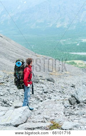 Mountaineer With Backpack In The Mountains On The Pass