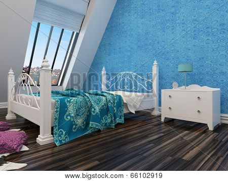 Modern white wrought iron double bed with an ornate foot and headboard against a blue wall under a sloping window