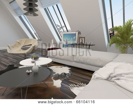 Bright airy modern living room interior with a cream modular corner lounge suite and large sloping windows in a white wall