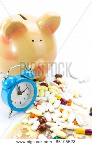 Piggy bank with pile of pills, banknotes and clock isolated