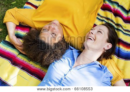 Two Woman Lying On Blanket