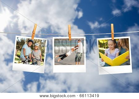 Composite image of instant photos hanging on a line against cloudy sky