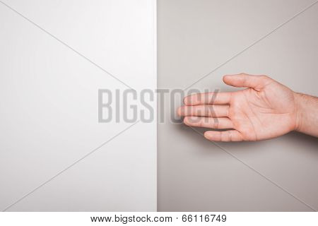 Offering Handshake Against Split Colored Background