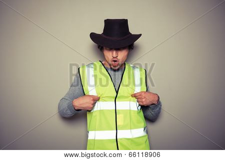 Cowboy Builder Wearing A High Visibility Vest And Being Rude