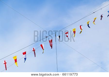 Flags Of Different Countries On The Mast Of The Ship