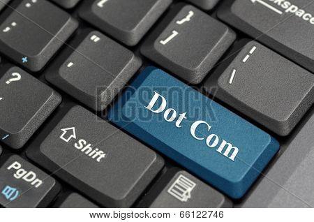 Blue dot com key on keyboard
