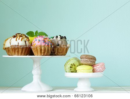 holiday desserts, decorated cupcakes and colorful macaroons