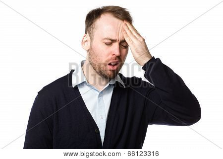 Man Rubbing His Throbbing Forehead With His Hand