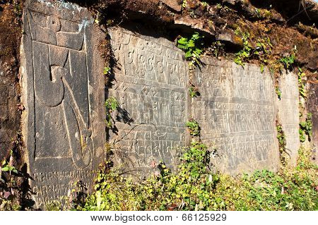 Mani Wall And Stones With Buddhist Symbols