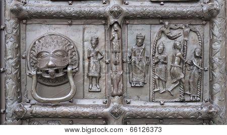 Door Knocker And Bas-relief Of Ancient Bronze Gate
