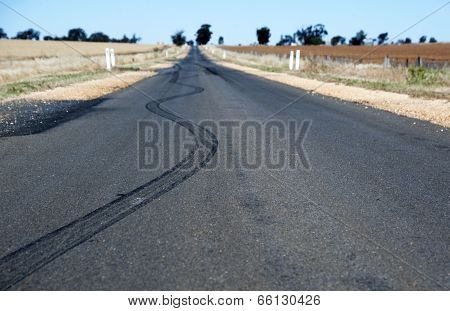 Tyre skids on a remote asphalt road