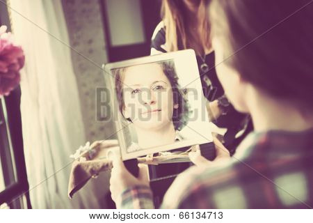 Bridesmaid looking in mirror after getting hair done