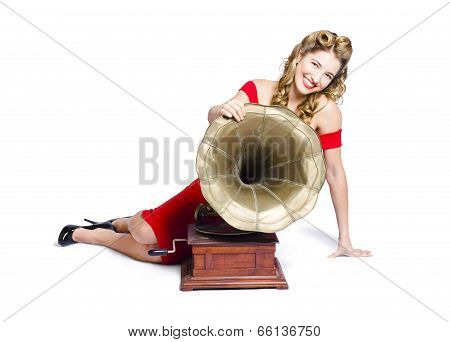 Beautiful Pinup Woman Listening To Old Gramophone