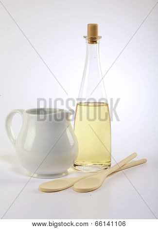 Jug Olive Oil And Wooden Spoon