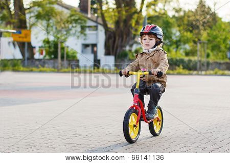 Little Toddler Boy Having Fun And Riding His Bike