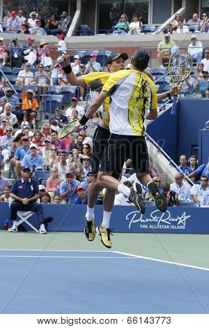 Grand Slam champions Mike and Bob Bryan celebrating victory after match at US Open 2013