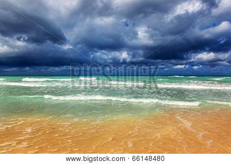 Storm clouds over a sandy beach