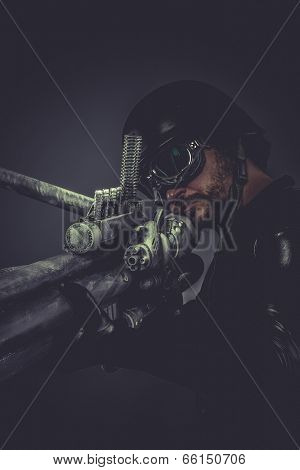 Futuristic. Starfighter with huge plasma rifle, fantasy concept, military helmet and goggles motorcyclist