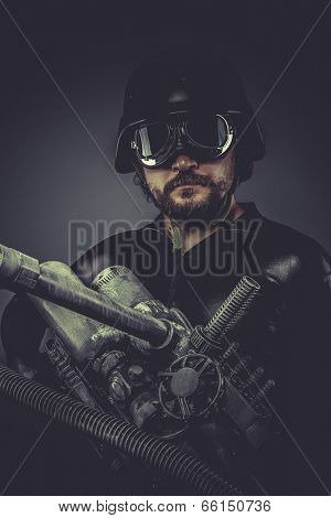Robot.Starfighter with huge plasma rifle, fantasy concept, military helmet and goggles motorcyclist
