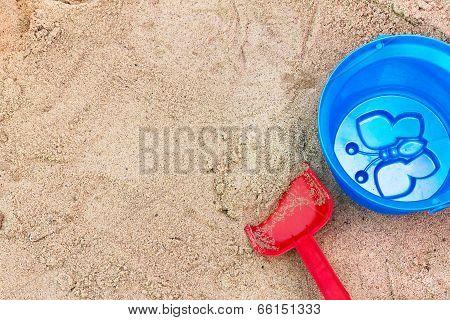 Children's Toys In The Sandbox.