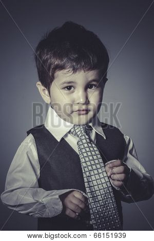 workaholic boy in suit and tie, Business concept