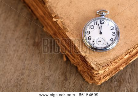 Pocket Watch On Book