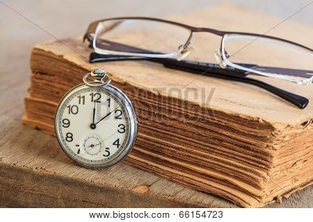 Pocket Watch Next To Book
