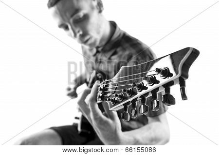 Young Man Playing Guitar Over White Background
