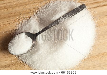 Spoon In A Pile Of Sugar