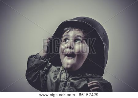 soldier fun and funny child dressed in military cap, playing war games
