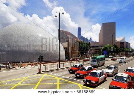 HongKong traffic day, red taxi and landmark buildings