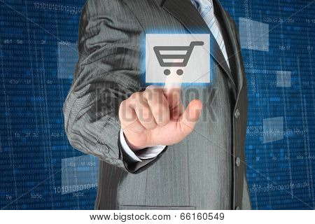 Businessman pushing virtual shopping button