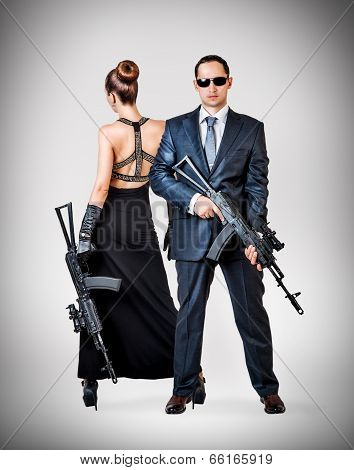 Fashionable Couple With Automatics