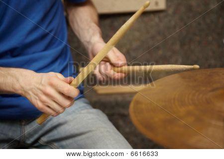 boom sticks in hands of drummer