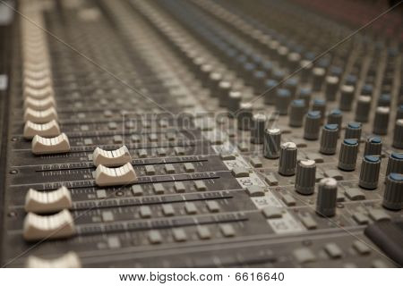 faders of dusty sound mixer. two faders in focus