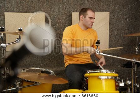 drummer near drumkit. microphone in out of focus