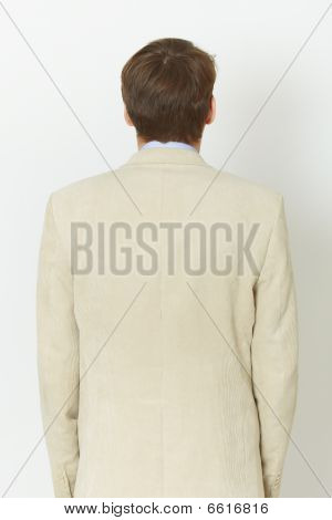 Young Man In Light Jacket - Rear View