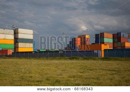 composed many containers on blue sky background