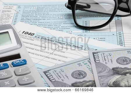 United States Of America Tax Form 1040 With Calculator, Dollars And Glasses