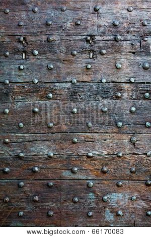 Old, Brown Wooden Surface With Metal Knobs