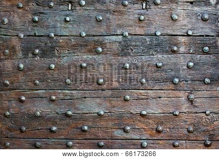 The Old Wooden Surface With Metal Knobs