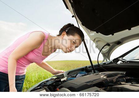 Woman Looking Under Hood Car