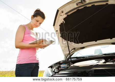 Woman With Book In Front Of Car