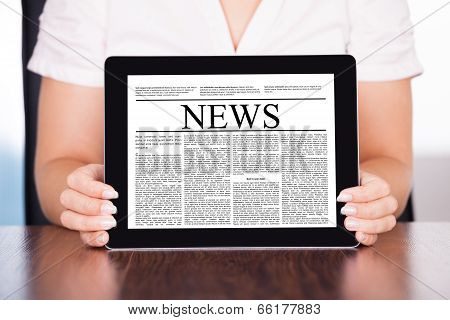 Woman Holding Touch Screen Tablet Pc With Business Article