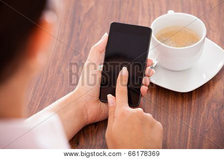 Woman With Mobile Phone And Cup