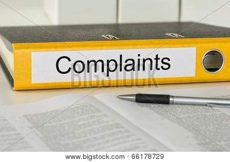 A yellow folder with the label Complaints