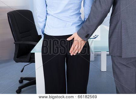 Businessman Flirting Businesswoman